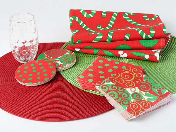 Exclusive holiday party collection:  Woven placemats, colorful paper napkins, sturdy double-sided paper coasters, and vibrant cotton kitchen towel set.